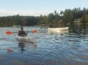 Jemilla paddling clear kayak front view