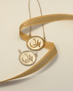 "Two sterling pendants of the Ancient Hebrew letters showing Chen or ""Grace"" designed by Marla Jean Clinesmith"