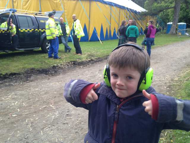 Michael with ear defenders on at music festival