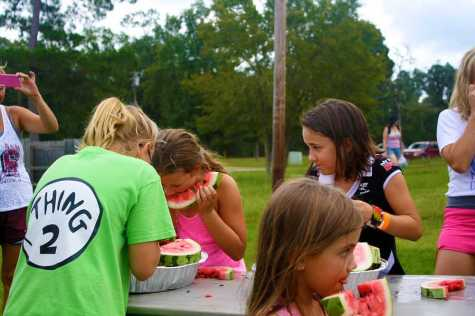 The 10 and under children's group chew through five pieces of watermelon.
