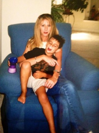 Mikey being his fidgety self as his mom tries to control him. Provided photo