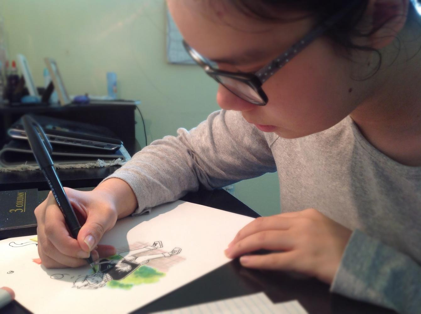 Sophomore+Lynn+Joustra+sits+at+her+desk+sketching+characters+from+her+comic.+Joustra%2C+who+likes+to+draw+out+her+problems%2C+enjoys+having+time+to+herself+to+evaluate+situations.%0A