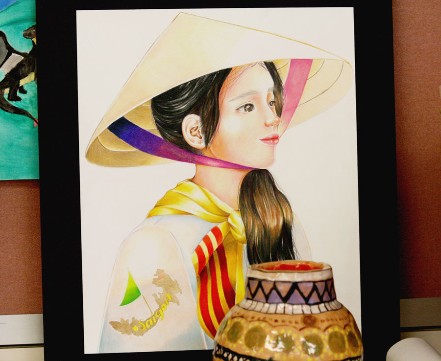 Two+art+pieces+that+were+entered+into+the+Hispanic+Heritage+Month+art+contest+that+was+held+from+Sept.+15+to+Oct.+15.+The+first+prize+winner+was+junior+Evelyn+Kha+who+made+the+portrait+in+the+photo.