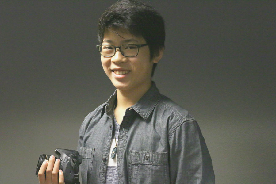 Junior Jacob Vu poses with a camera. He got his first camera, a Sony Handy-cam, when he was 9 years old. Currently, he usually uses a Canon camera for filming or photography.