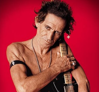 Keith Richards with a guitar and - yikes! - nearly no clothes on.