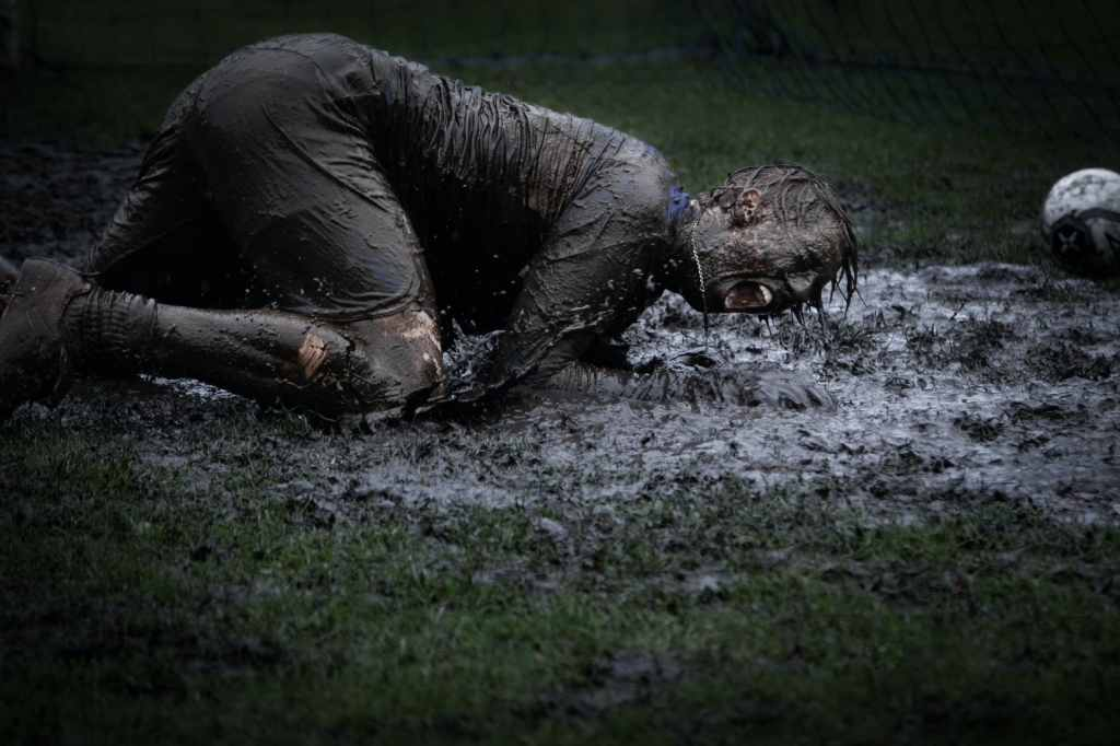 Man rolling in mud
