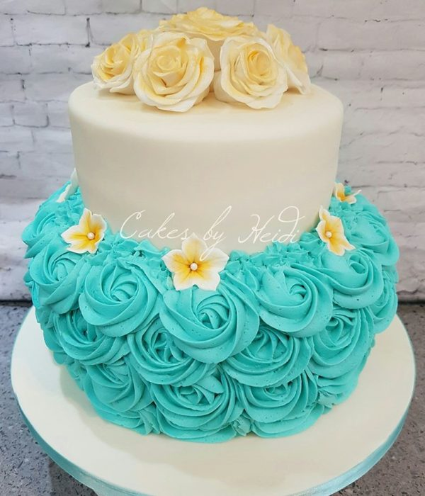 Two tiered white and blue wedding cake