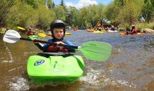 PaddleFest in Buena Vista boy in Kayak
