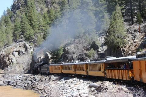 the Durango & Silverton Narrow Gauge Railroad chugging through the canyon HeidiTown.com