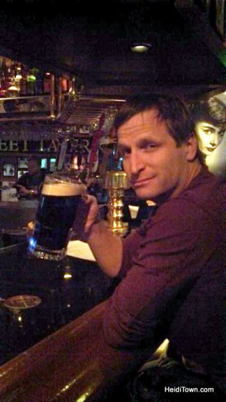 Ryan drinks a huge Guinness at Maloney's on Denver, Colorado. HeidiTown.com