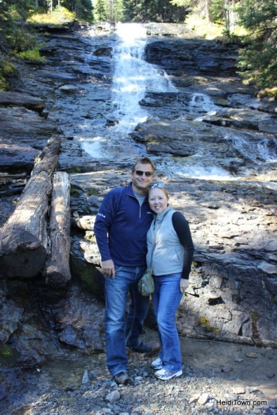 Posing with a waterfall on the way to the top of Imogene Pass with Alpine Scenic Tours out of Ouray, Colorado. HeidiTown.com