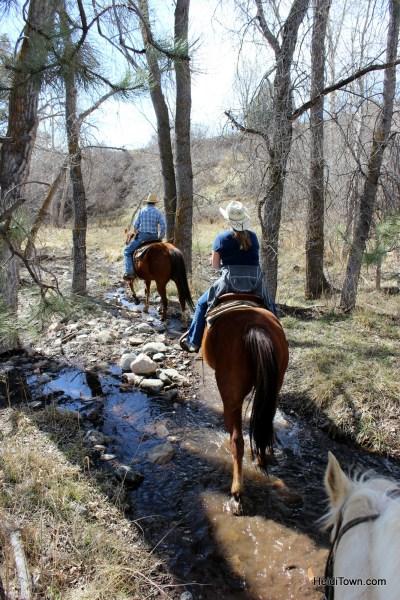 Riding through a stream at Sylvan Dale Guest Ranch. Playing Cowgirl at Sylvan Dale Guest Ranch. HeidiTown.com