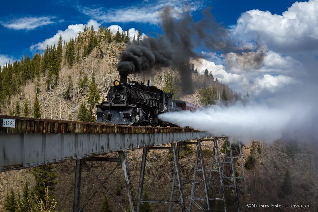 The train crosses the bridge at the Cascades along the Cumbres & Toltec Scenic Railroad route. HeidiTown.com, photo by Alanna Brake