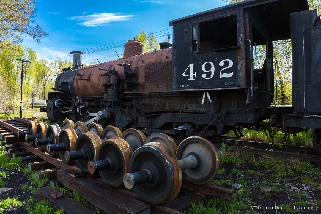 Cumbres Toltec Scenic Railroad, Charmed by Chama, engine 492 sitting in the rail yard at Chama. Photo by Lucky Brake, Ltd.