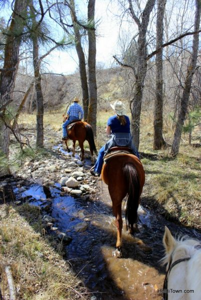 Riding through a stream at Sylvan Dale Guest Ranch. Playing Cowgirl at Sylvan Dale Guest Ranch. HeidiTown.com (2)