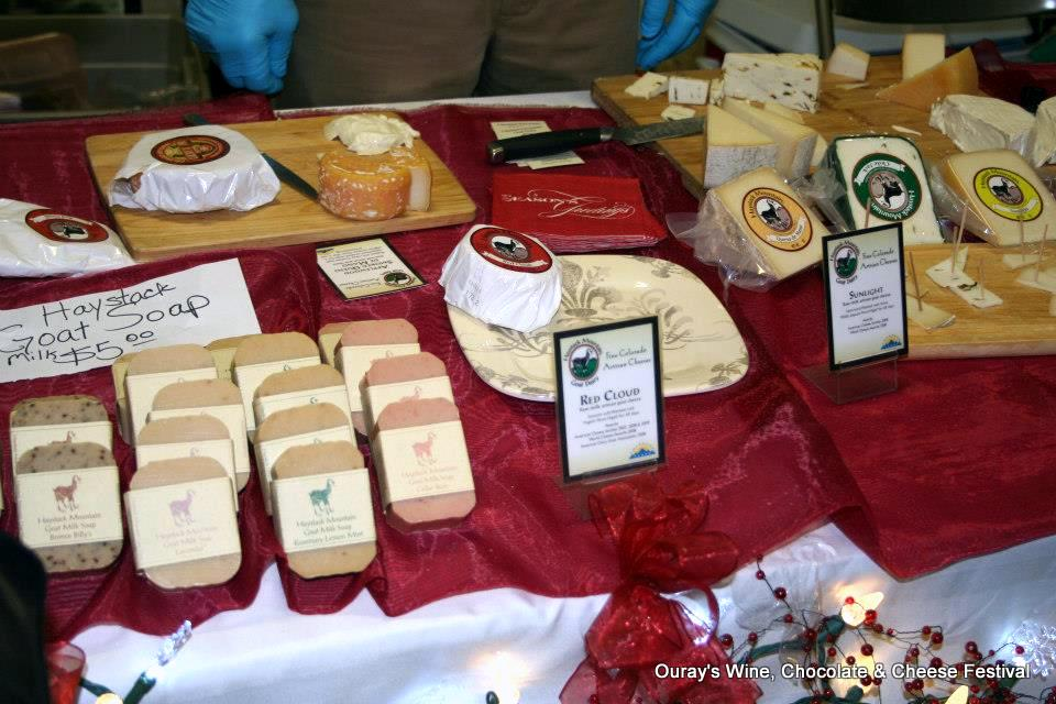 Spend Christmas in Ouray. Cheese table at Wine, Chocolate & Cheese Festival. HeidiTown.com