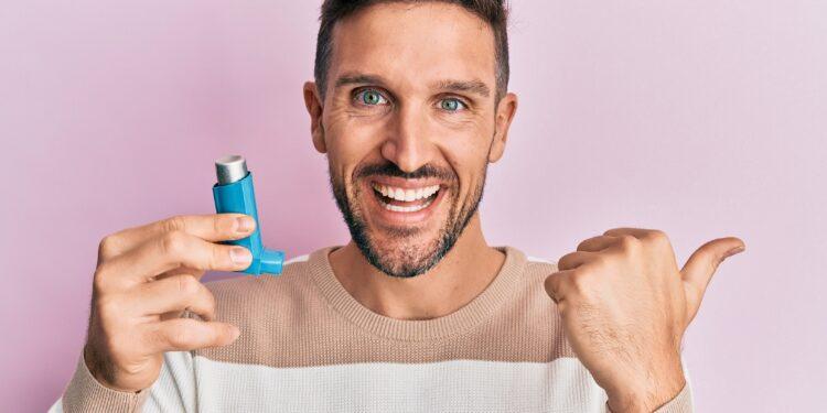 Man using asthma spray.