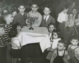 A children's Hanukkah celebration sponsored by the Friendship Club, c. 1950. Earnest Nachman Photographs, Rauh Jewish History Program & Archives at the Heinz History Center.