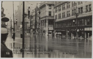 ALT:Flood waters at Liberty Ave. looking west from Wood Street, downtown Pittsburgh, March 17-20, 1936.General Postcard Collection, GPCC, Detre Library & Archives, Senator John Heinz History Center.