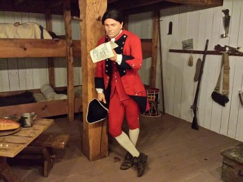 """Sergeant """"Adam Samm"""" wearing a sergeant's uniform of the Royal American Regiment on display at the Fort Pitt Museum."""