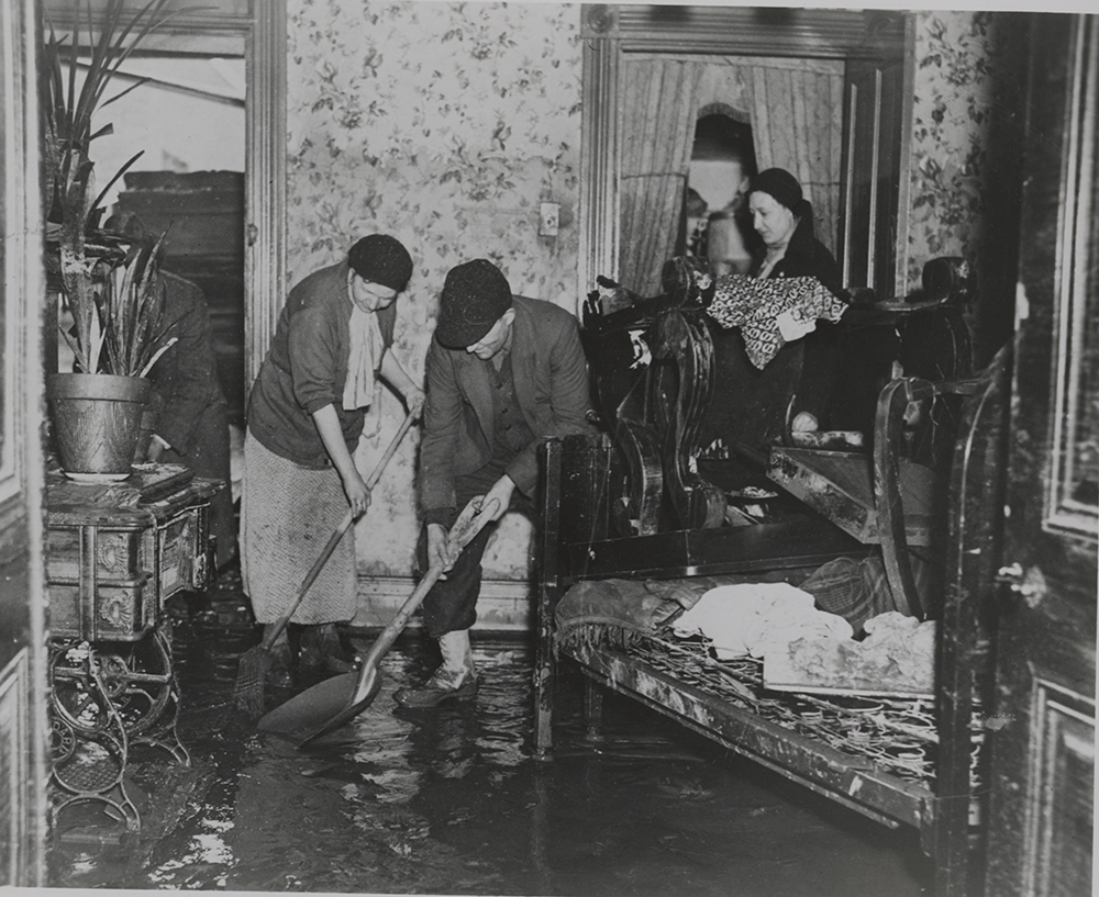Cleaning up after the flood, 1936. | St. Patrick's Day Flood | Heinz History Center