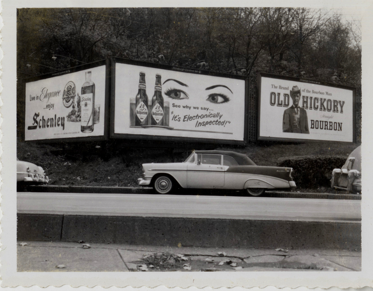 """It's Electronically Inspected!"" Parking along a Duquesne Pilsener billboard, late 1950s. 