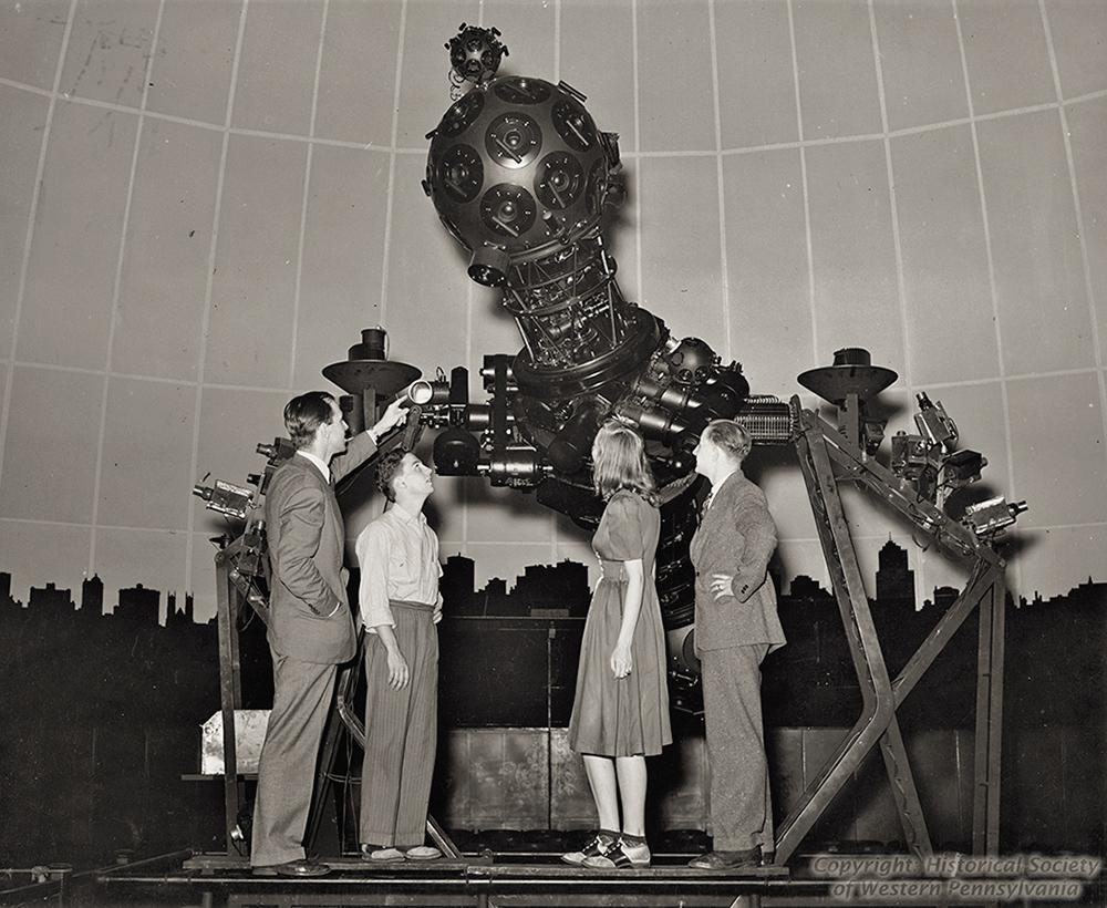A high school aeronautics class visits the Zeiss II projector.