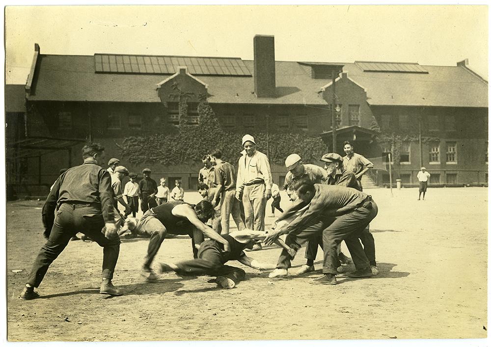 Dorsey watches men play a rough and tumble game at Washington Park, 1922.