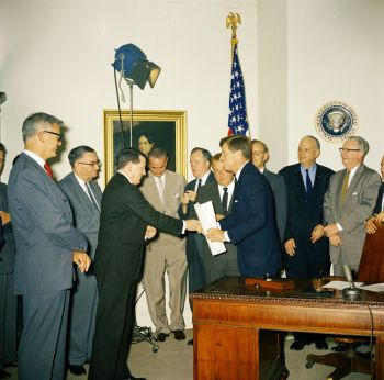 President Kennedy signs National Aeronautics and Space Administration (NASA) Authorizations, July 21, 1961.