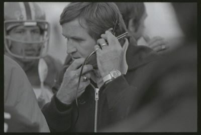 """Pitt Coach Johnny Majors coaches in the """"Backyard Brawl"""" rivalry game against West Virginia University on Nov. 13, 1976 at Pitt Stadium. Pitt went on to win the National Championship after posting a 12-0 record in Majors' fourth season as head coach. Gift of Anthony Kambic, PSS 30, Detre Library & Archives at the History Center."""
