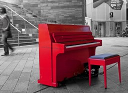 A Red Piano on a Grey Day