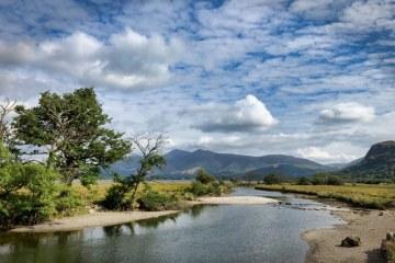 River Derwent flowing into Derwentwater, Borrowdale, English Lake District.