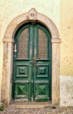 LISBON green doors and furniture in old town Thursday doors
