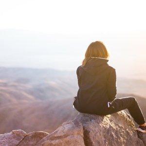 illustration of woman on mountain peak