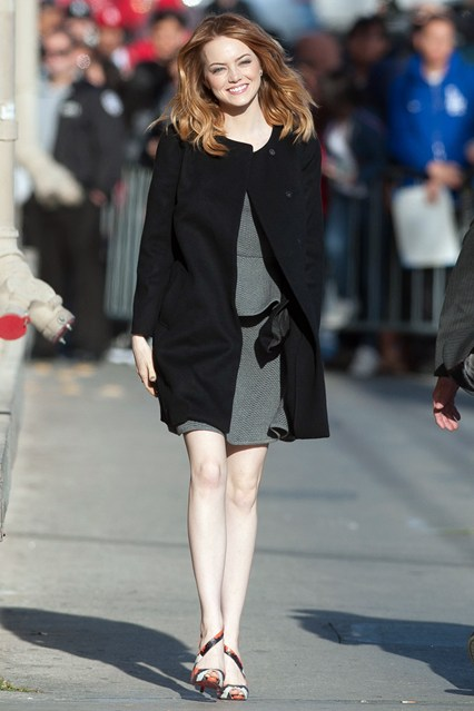 statement shoes 2014;   Emma Stone at Jimmy Kimmel Live, LA, April 3 2014: black collarless coat, grey dress, Christian Louboutin Viveka Snakeskin Sandals with asymmetrical straps.