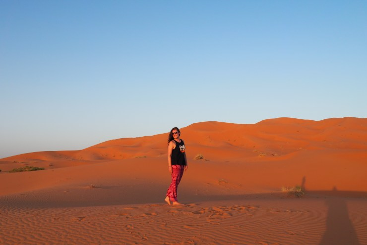 Playing in the sand dunes of the Sahara Desert, Morocco.