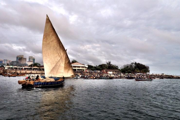 Tradirional dhow sailing into Dar es Salaam Harbour. Kenya and Tanzania Itinerary.