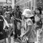 BUBBLE-MAN, NYC © KEN SHUNG.Black and white framed print -street scene, people surrounded by bubbles