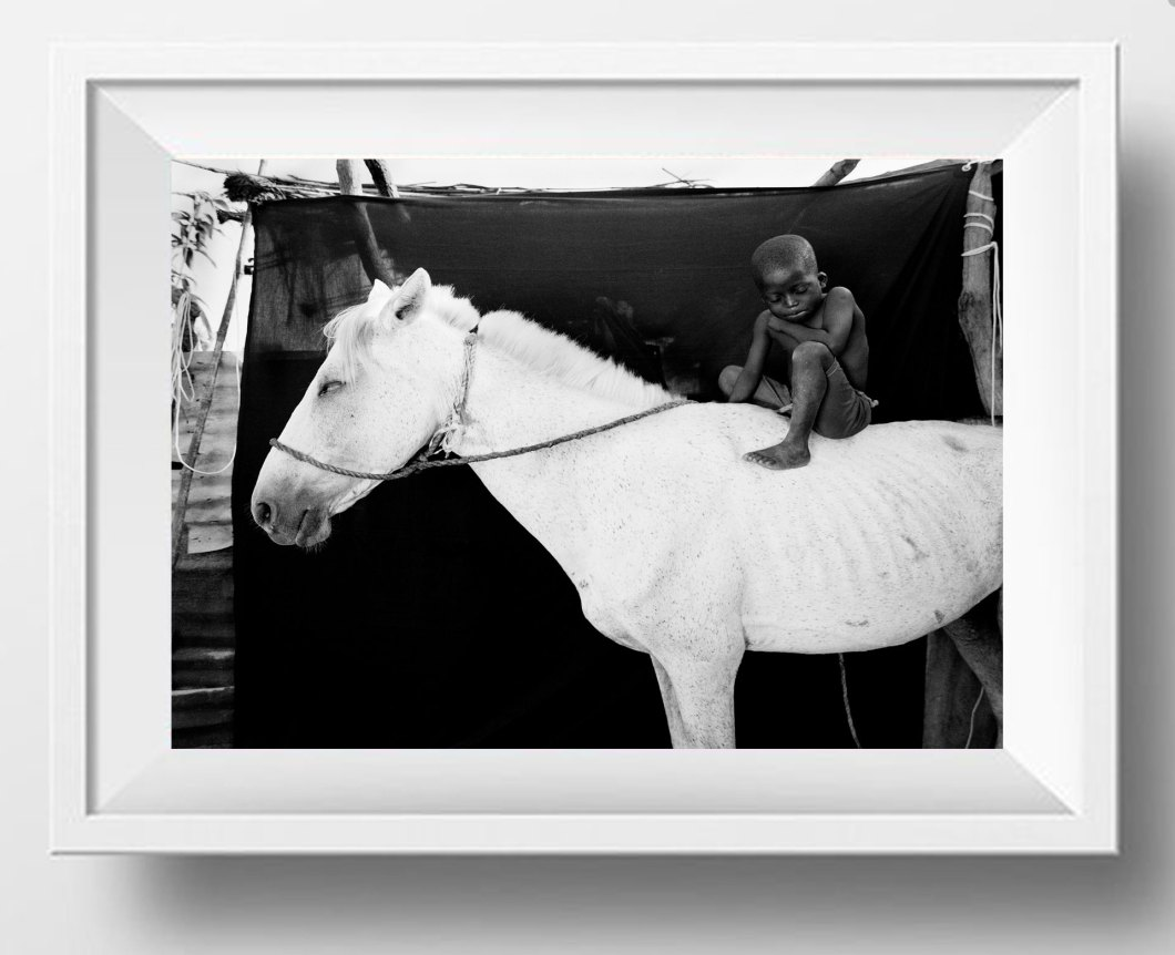 ©JASON FLORIO - 'ISMAILA ON HIS WHITE HORSE, JUMPEX'. Black & white framed print -small boy on horseback