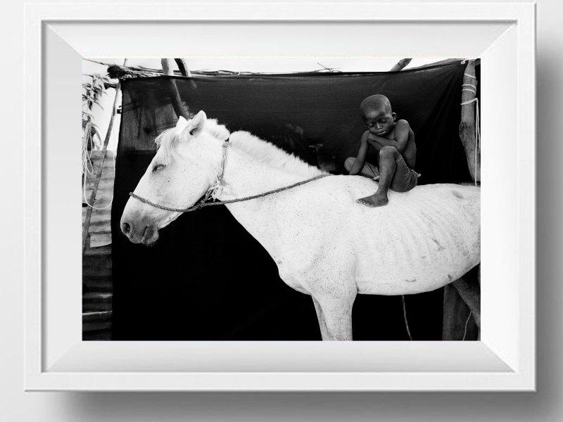 ©JASON FLORIO - 'ISMAILA ON HIS WHITE HORSE, JUMPEX'. Black & white framed print -small boy on horseback