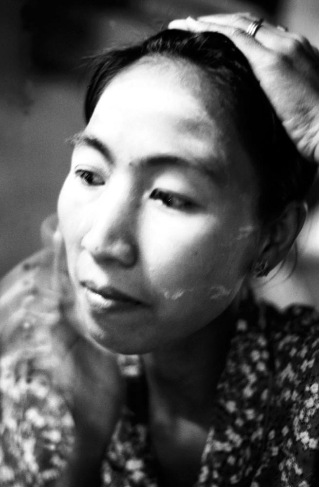 Jason Florio photography - Black & White image of Burmese woman with a white (thanaka) powdered face, Burma / Myanmar