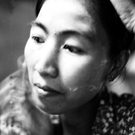 ©Jason Florio - Burmese Woman with Powdered Face. BW portrait