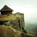 ©Jason Florio 'Mequet Mariam Village#2, Ethiopia ' Color- a cliff side hut, on the edge of a cliff, in the Ethiopian Highlands