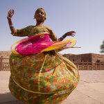 ©Jason Florio - Dancing Girl, India. Color young Indian Girl, twirls around in a long dress