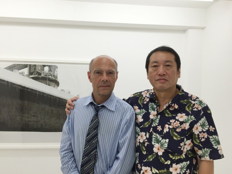 Portrati of photographers Michel Delsol and Keizo Kitajima -in his studio/gallery, Kyoto, Japan, standing side by side