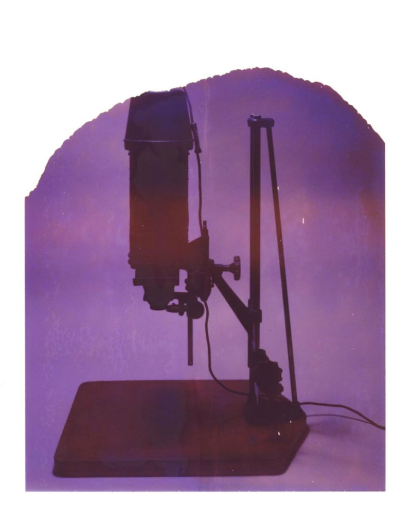 Exhibition News Oskar Landi - Polaroid image of a photographic print enlarger