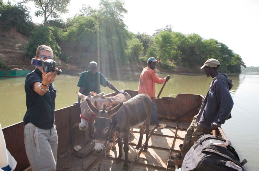Helen Jones-Florio and the two donkeys crossing the River Gambia in a small local ferry ©Jason Florio