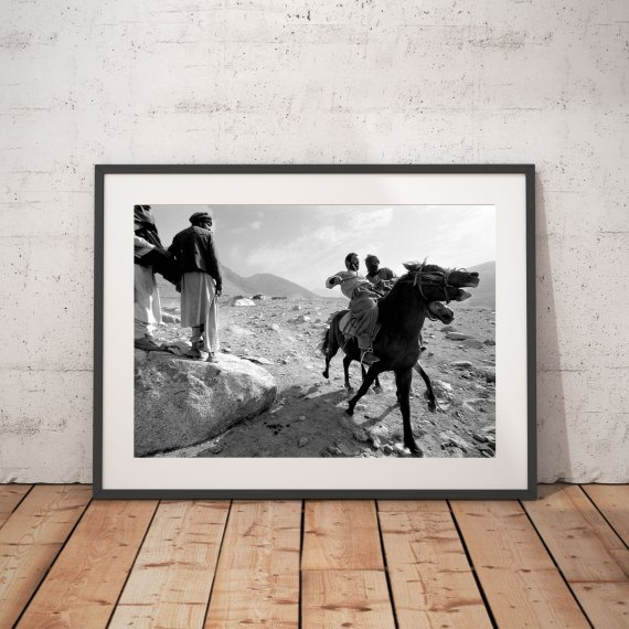 'AFGHAN NOMADS & HORSES' © JASON FLORIO BW men on horses playing Buzkashi in desert