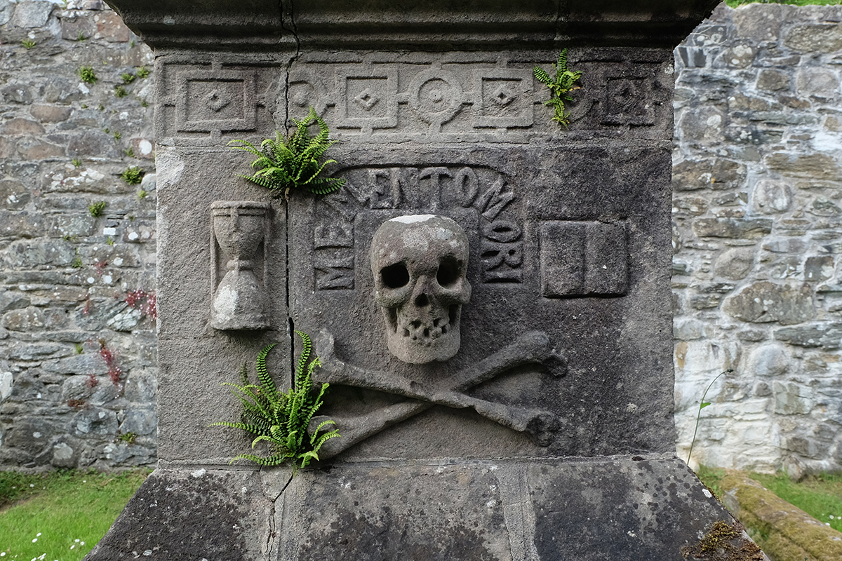 Skull and crossbones gravestone inside the ruined kirk at Anwoth