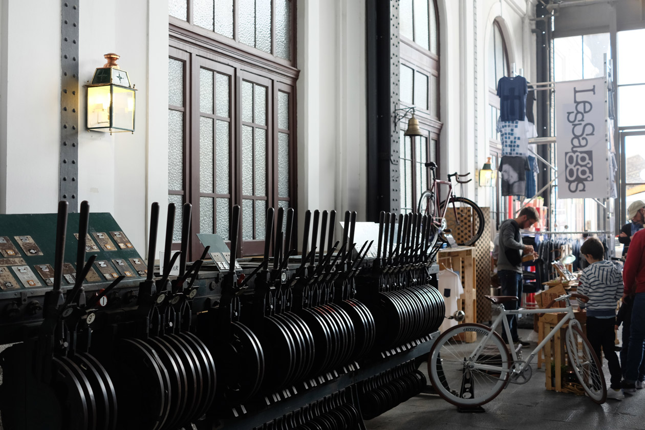 A stall selling quirky bikes beside the old levers of the railway station